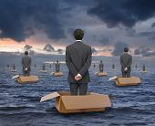 image of box-end  - businessman floating at sea in a cardboard box - JPG
