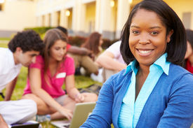 foto of playground school  - High School Teacher Sitting Outdoors With Students On Campus - JPG