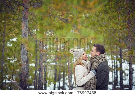 Young couple dating in winter park