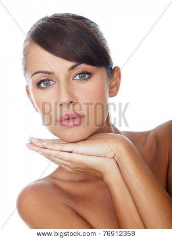 Close up Gorgeous Bare Woman Putting Tattooed Hands on the Chin While looking at the Camera. Isolated on White Background.