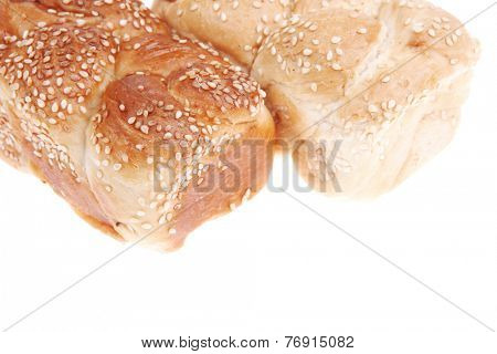 hot bun of light wheat bread topped by sesame seeds isolated over white background