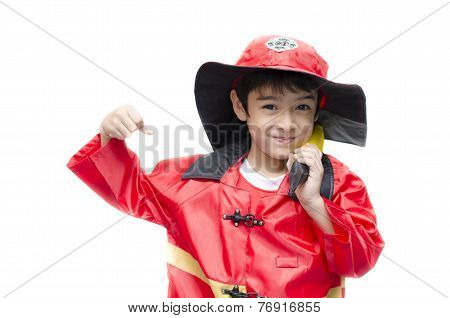 Little Boy Pretend As A Fire Fighter On White Background