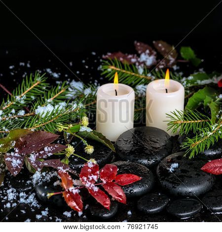 Winter Spa Still Life Of Evergreen Branches, Leaves With Drops, Snow, Candles On Zen Basalt Stones,