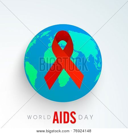 Shiny red ribbon of aids awareness on globe for World Aids Day concept.