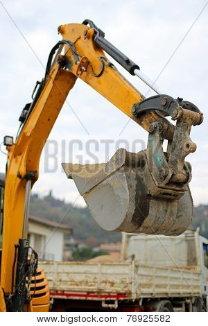 Bucket Of A Bulldozer And A Truck In The Background During The Roadworks