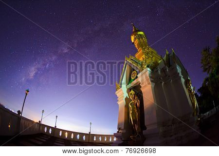 Milky Way at Standing gold Buddha image name is Wat Sra Song Pee Nong in Phitsanulok, Thailand