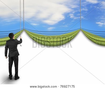 Businessman Pulling Open Natural Sky Meadow Curtain Revealed Blank White