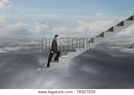 Businessman Climbing On Concrete Stairs With Natural Cloudy Sky Cloudscape