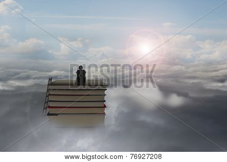 Pondering Businessman Sitting On Stack Of Books With Sunlight Cloudscape