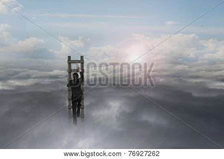 Businessman Climbing On Wooden Ladder With Natural Sunlight Sky Cloudscape