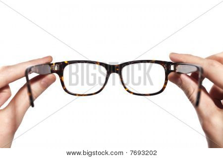 Glasses With Horn-rimmed In Human Hands Isolated