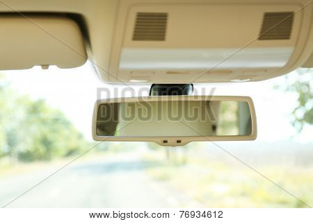 Car rear view mirror, close up