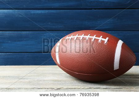 Rugby ball on wooden background