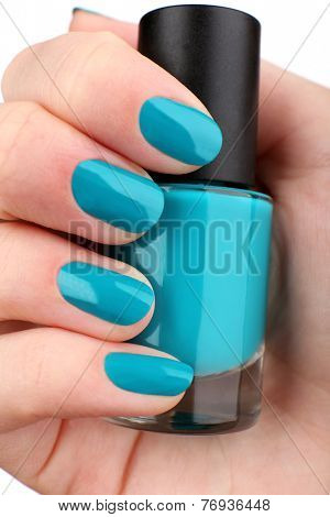 Nail polish in hand, close-up