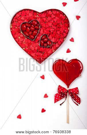 Heart shaped box with Valentine's Day candies on the white background