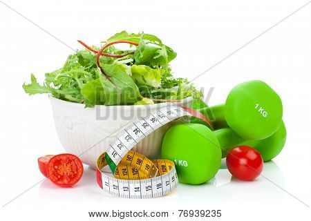 Two green dumbells, tape measure and healthy food. Fitness and health. Isolated on white background