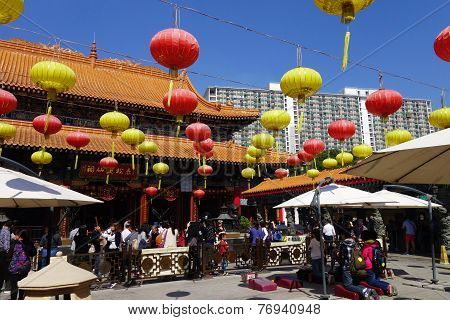 Unidentified People Prays In The Famous Wong Tai Sin Temple In Hong Kong