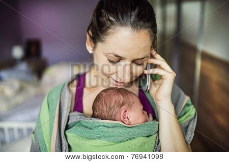 Mother with baby in the wrap carrier