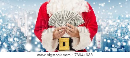 christmas, holidays, winning, currency and people concept - close up of santa claus with euro money over snowy city background