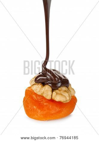 Chocolate Pouring On Walnut And Apricots Isolated On White Background