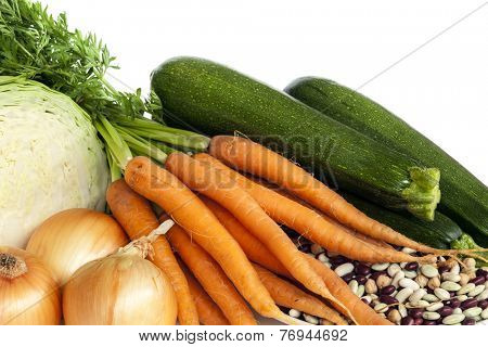 Ingredients for vegetable soup with beans.  Includes cabbage, onions, carrots and zucchini, with mixed dried beans.