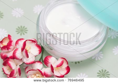 Open Jar Of Cream With Flowers
