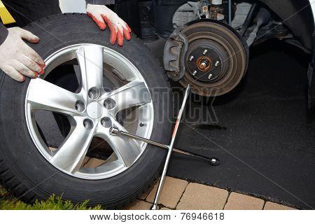 Car Mechanic Changing Tire.
