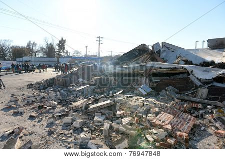 FERGUSON, MO/USA - NOVEMBER 25, 2014: Smoldering remains of Prime Beauty Supply in Ferguson in the aftermath of riots after announcement of Grand Jury decision