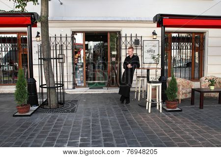 Budapest - June 27:  The Waiter Stands At The Entrance To The Restaurant In Historic District Of Bud