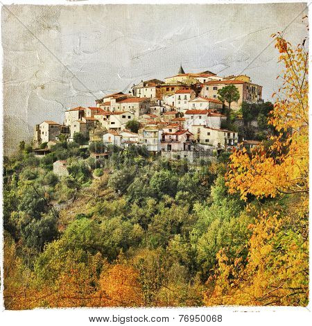autumn scenery with hill top village in Italy, artistic picture
