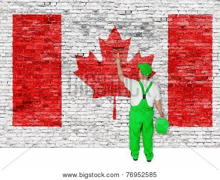 Professional House Painter Covers Wall With Flag Of Canada