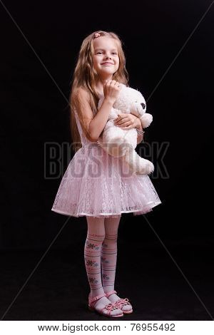 Happy Girl Standing With Teddy Bear