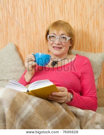Senior Woman Reading Book