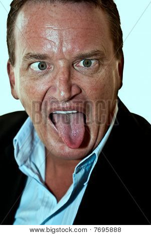 Businessman Pulling Silly Face