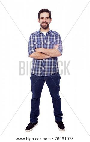 Full body portrait of young casual man smiling, isolated on white background