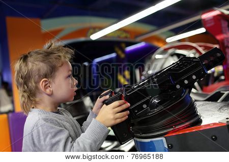 Child Playing A First Person Shooter