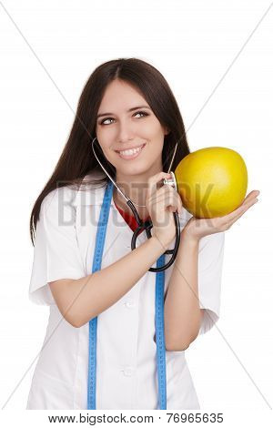 Nutritionist Doctor Checking a Pomelo Fruit