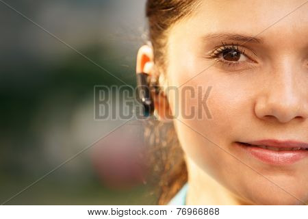 Business Woman With Phone Bluetooth Headset Smiling