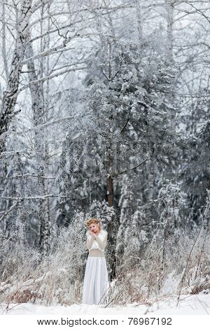 Image og beautiful woman in the winter forest