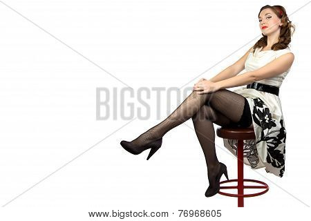 Photo of the woman sitting on bar stool