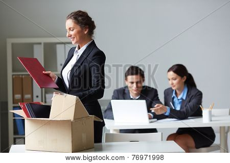 Female employer unpacking her things
