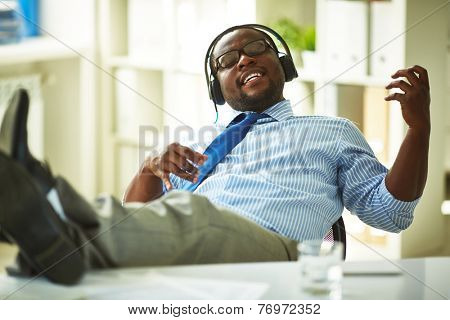Businessman sitting in headphones in office