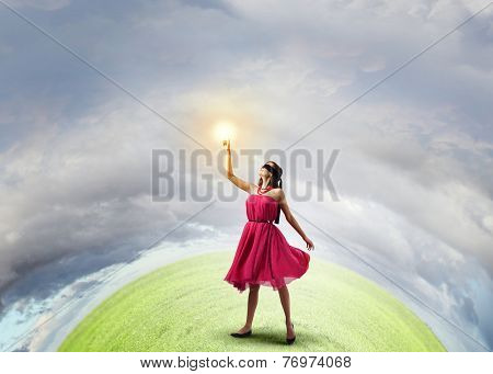 Young woman in blindfold standing on green Earth