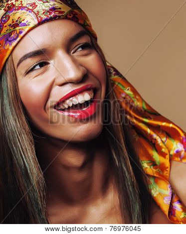 beauty young happy afro american woman in shawl on head