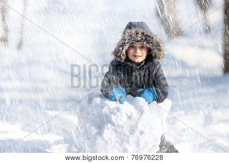 Cute Boy Playing With Snow In The Winter Park
