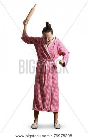 angry housewife in dressing gown holding rolling pin, looking down and screaming. isolated on white background