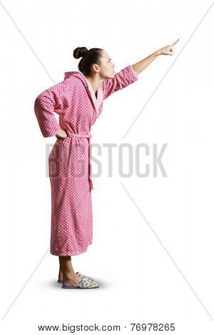 strict housewife pointing up. isolated on white background