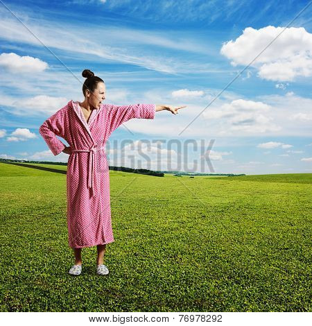 discontented housewife screaming and pointing at something. photo at outdoor
