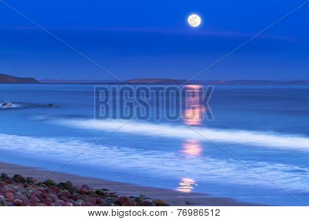 Full moon at Atlantic ocean in Ireland
