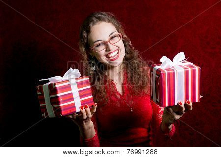 Happy Girl In Glasses With Two Gifts.